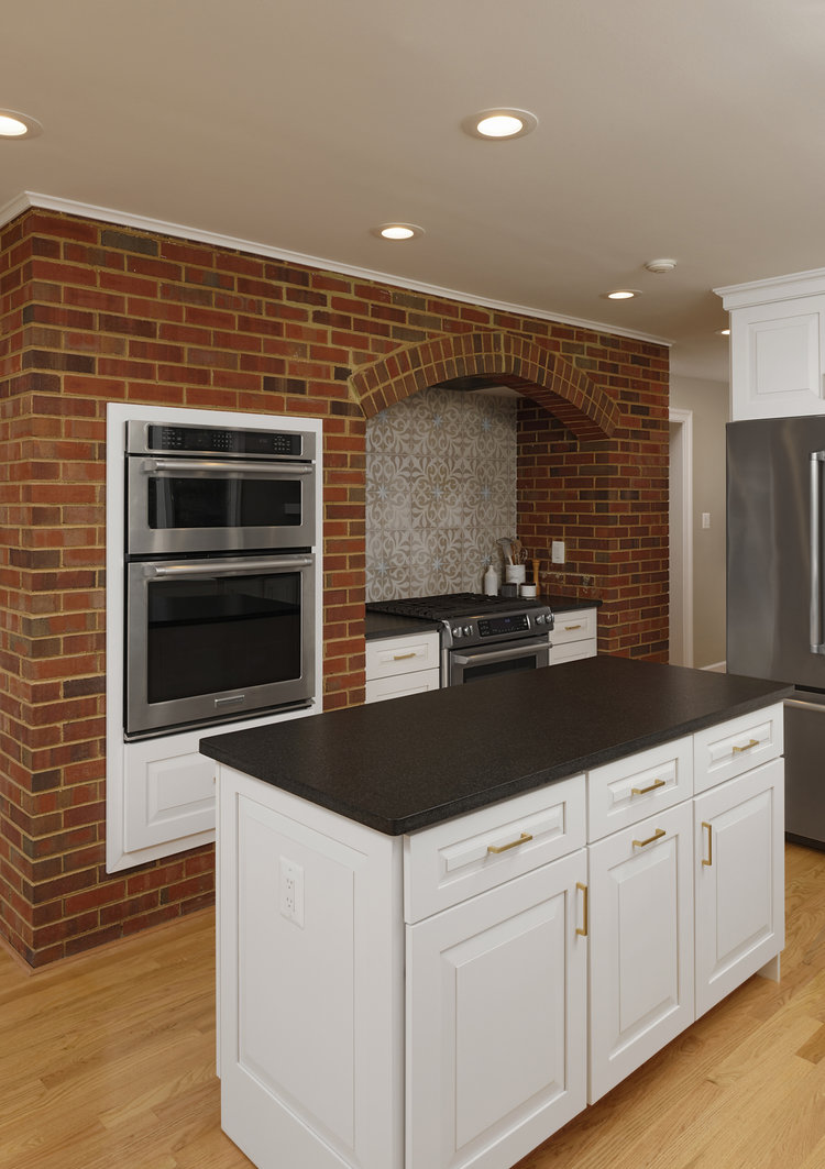 A brick wall in a kitchen  remodeling job