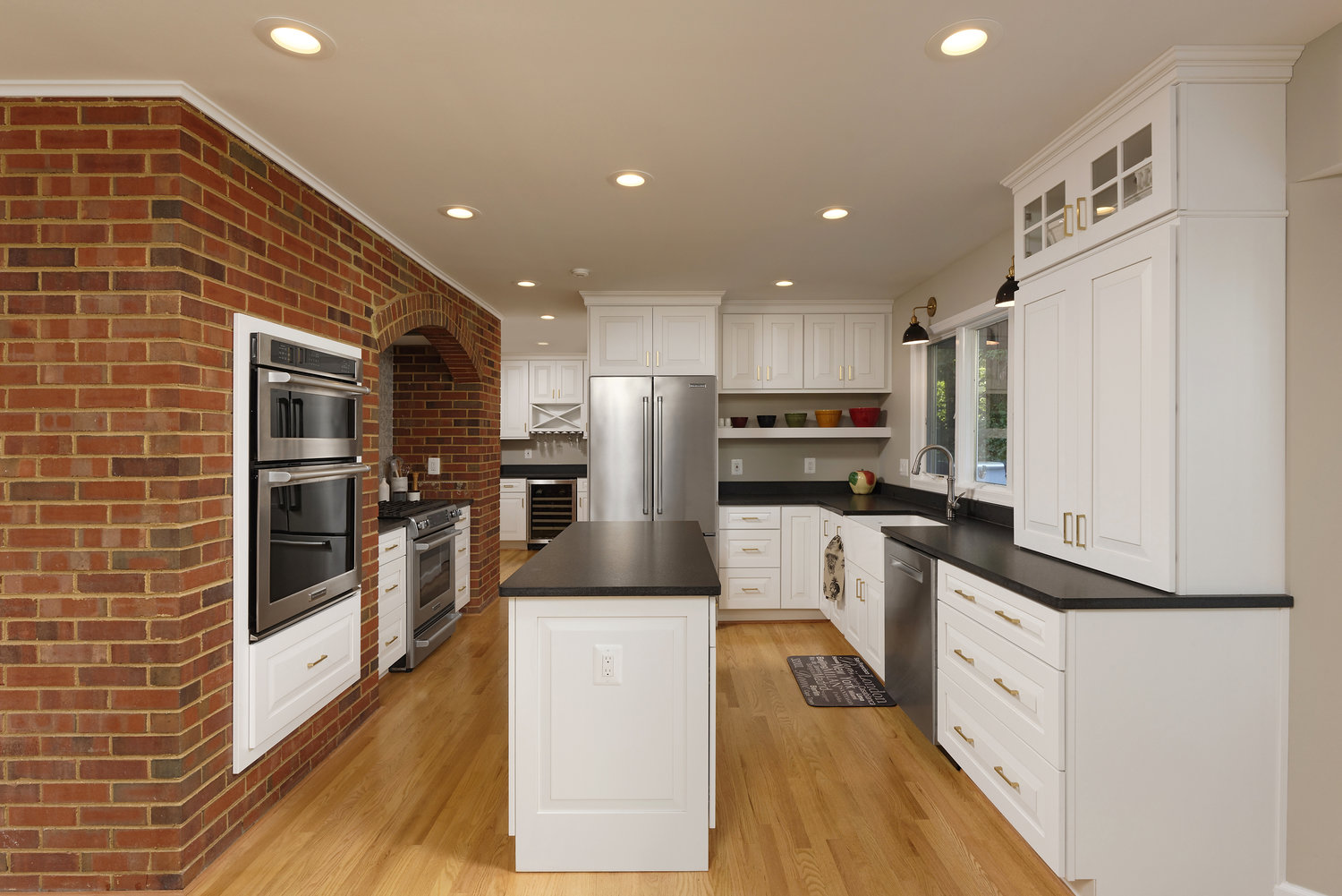 Image of kitchen where the owners chose home flooring in wood