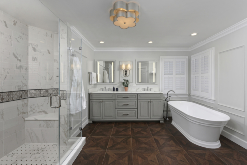 a traditional master bathroom with wood look floor tile