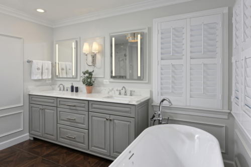 a traditional mast bathroom with plantation shutters on the windows