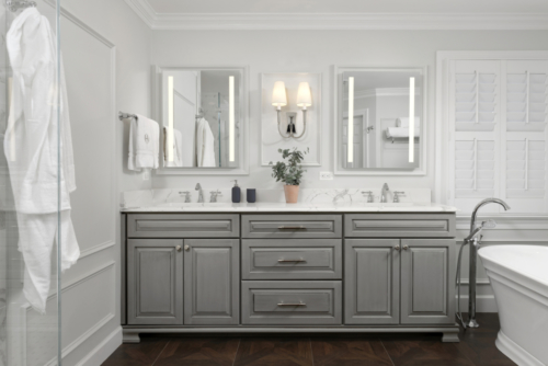 a traditional master bathroom with gray cabinets and a white quartz countertop